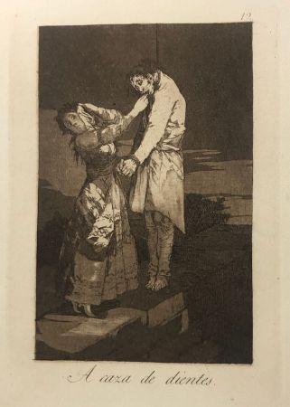 Офорт Goya - Capricho 12 . A caza de los dientes
